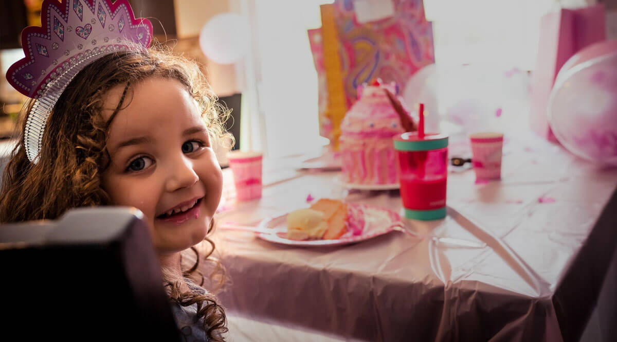 Norah, a young girl with autism, celebrating her birthday