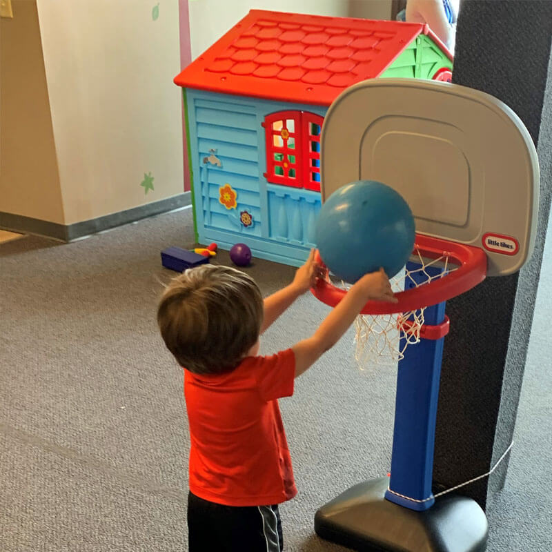 A boy with autism playing basketball