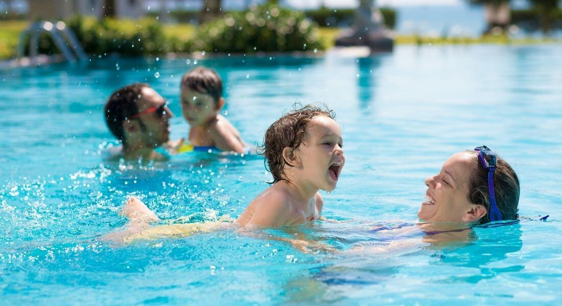 Parents and Child playing in the water